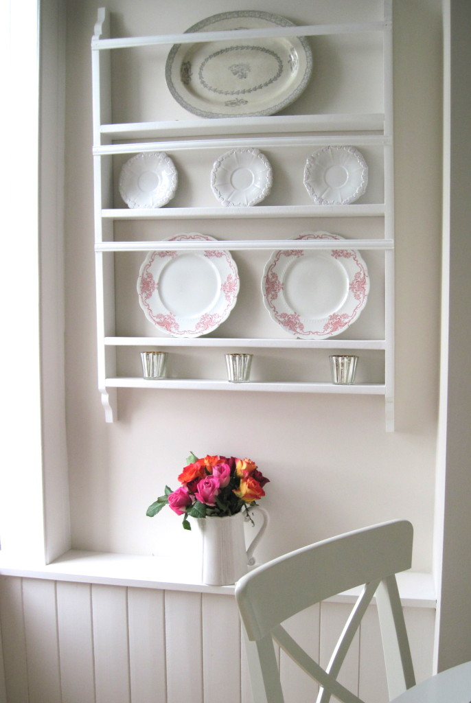 Painted white plate rack designed by Louise Keane of Amalfi White Living. Shown here with red and white transferware and an antique grey and white Swedish platter.