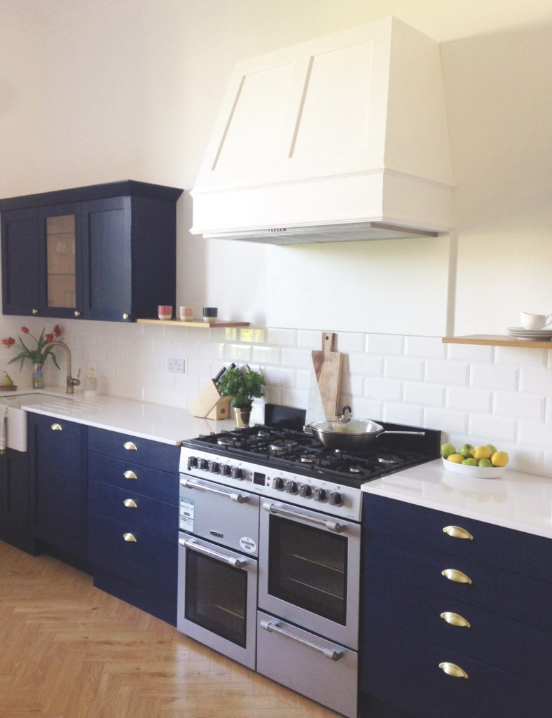 Edinburgh kitchen designed by Amalfi White Living in navy and warm grey with brass accent and an oak herringbone floor